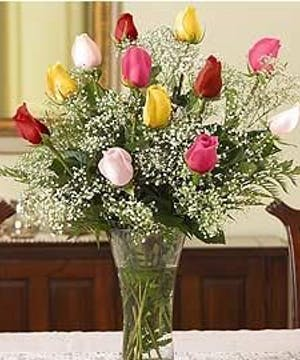 One dozen long stem roses in assorted colors.