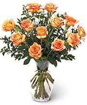 Dozen orange Roses vased and delivered