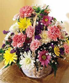 Basket of mixed multi colored flowers & filler