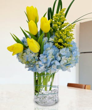 Send smiles with hydrangea & tulips.