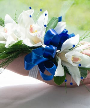 White Mini Cymbidium  accented with blue stones